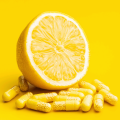 vitamin c pills and yellow lemon.jpg