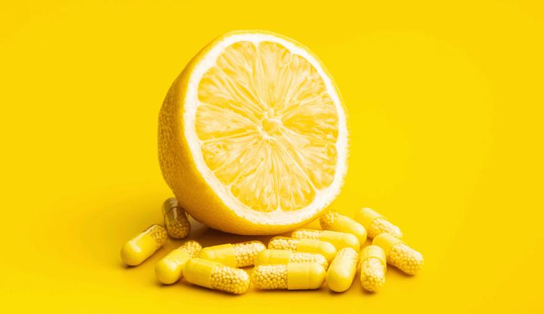vitamin c pills and yellow lemon.jpg